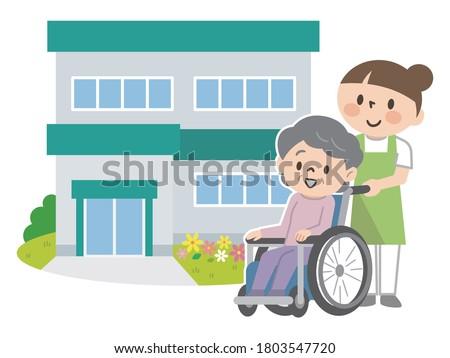 Senior women in nursing homes and wheelchairs and nursing staff ストックフォト ©