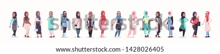 set arabic women in hijab different arab girls wearing headscarf traditional clothes female cartoon characters collection full length flat horizontal banner Stock fotó ©