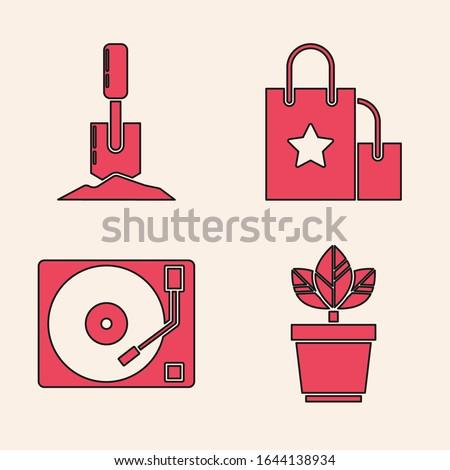 set flowers in pot  shovel in