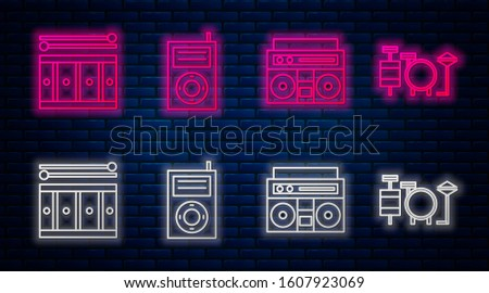 Set line Music MP3 player, Home stereo with two speakers, Drum with drum sticks and Drums. Glowing neon icon on brick wall. Vector