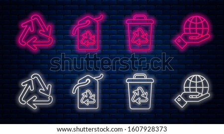 Set line Tag with recycle symbol, Recycle bin with recycle symbol, Recycle symbol and Human hands holding Earth globe. Glowing neon icon on brick wall. Vector