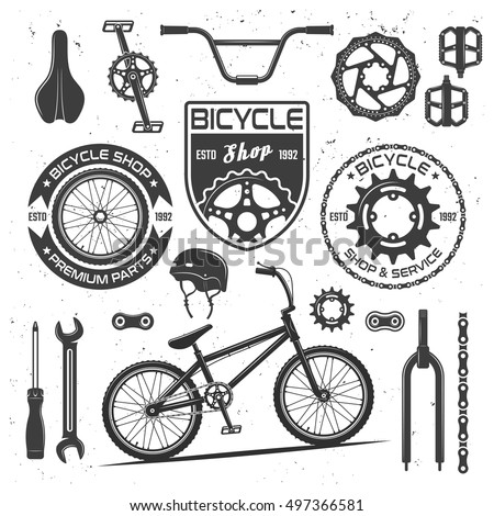 Set of bicycle vector black design elements, badges, labels and emblems isolated on white background with bike parts: sprocket, brake disk, pedal, chain, wrench and other objects