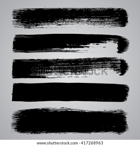 Set of black grunge brushstrokes on grey background vector illustration. Abstract hand drawn grunge banners #417268963