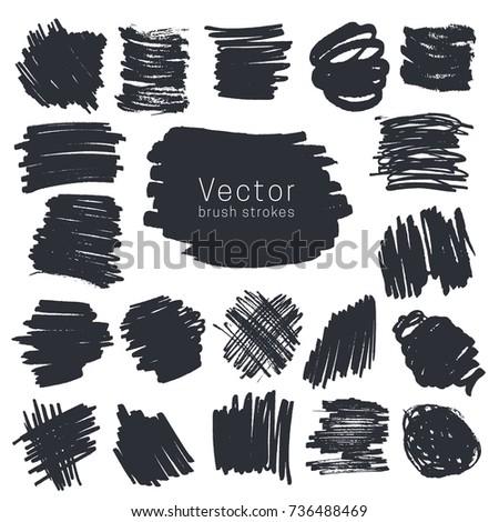 Set of black ink brush strokes isolated on white background