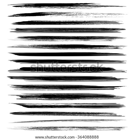 Set of black long abstract textured strokes isolated on a white background