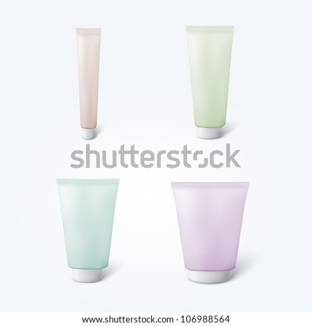 Set of 4 blank cosmetic tubes in different colors isolated on white background