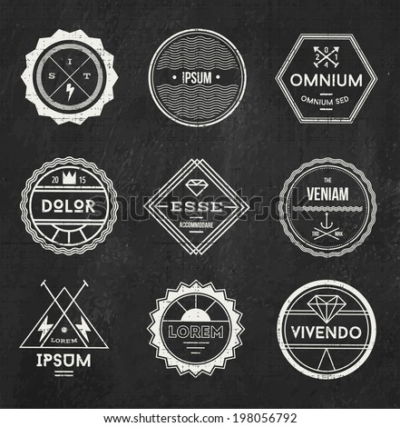 Set of blank retro vintage badges and labels on chalk board background