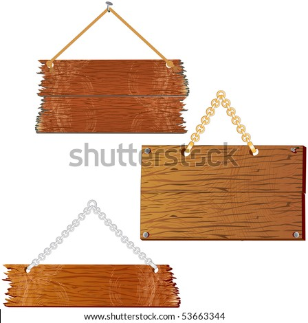 Set of blank wooden boards hanging on wall