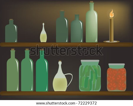 set of bottles with candle light