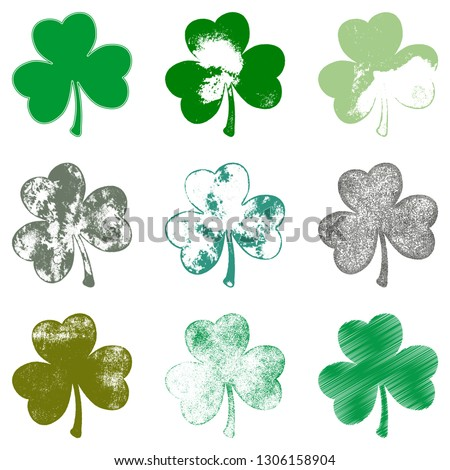 Set of Clover leaf in grunge style isolated on a white background. Distressed Patriks Day shamrock design element collection. Trefoil cutout shabby grainy template. EPS10 vector.