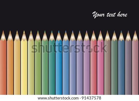 Set of colour pencils on black background