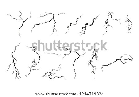 Set of cracks. Collection of different black lightning bolts. Earth crack. Set thunderstorm and lightning.Vector illustration of natural phenomena on white background.