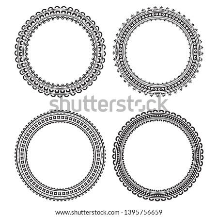 Set of 4 decorative black round frames for your design.