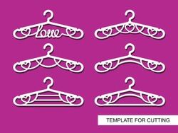 Set of decorative clothes hangers with a heart and the word love. Decorative items for atelier, wedding salon, boutique or store. Template for laser cutting, carving, paper cutting or printing. Vector