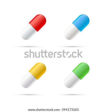 Set of different colours pills, capsules isolated on white