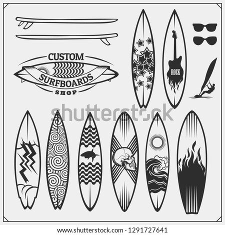 Set of different surfboards. Vector illustration. Surfing emblems, icons and labels.