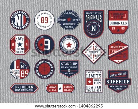Set of emblems on grey jeans background.
