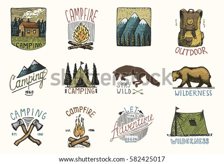 set of engraved vintage, hand drawn, old, labels or badges for camping, hiking, hunting with mountains, campfire and tent, axes. bear and backpack, wolf or red fox