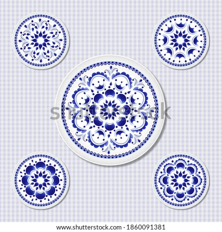set of five plates with a