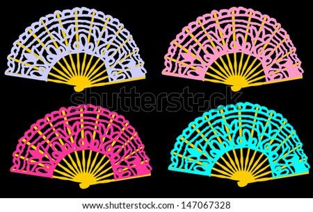 set of folding colorful spanish fans isolated on black background