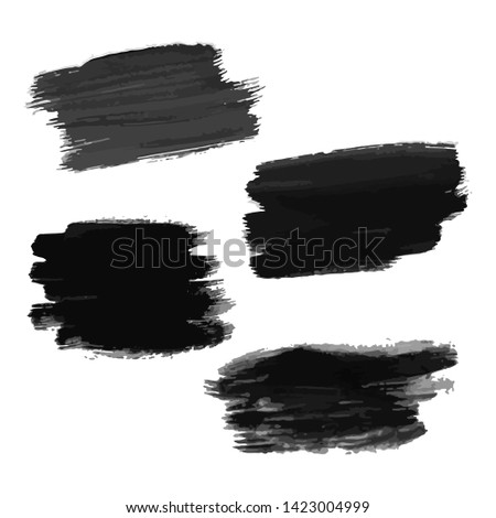 Set of four black hand drawn ink stains. Ink spots isolated on white background. Vector illustration