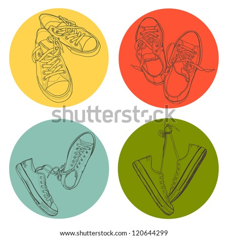 Set of four different pairs of sneakers drawn in a sketch style. Vector illustration.