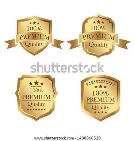Set of four gold badges. Premium badge. Vector element