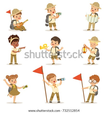 Set of girls and boys in scout costumes Foto stock ©