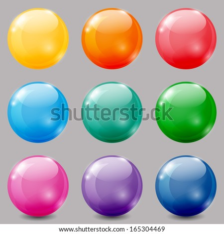 set of glossy colored balls on