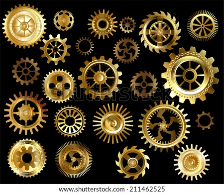 set of gold and brass gears on