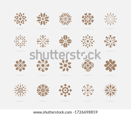 Set of golden abstract flower vector symbols