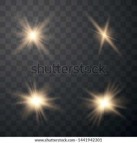 Set of golden glowing lights effects isolated on transparent background. Sun flash with rays and spotlight. Glow light effect. Star burst.