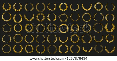 Set of 50 golden vector laurel wreaths on black background. Set of foliate award wreath for cinema festival.Vector illustration.