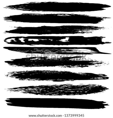 Set of grunge spots, strokes. Dry brush strokes vector #1373999345