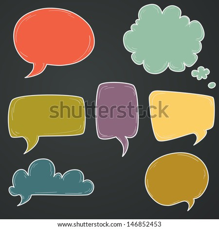 Set of hand drawn colorful speech and thought bubbles on chalkboard background.