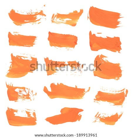 Set of hand drawn strokes of orange paint