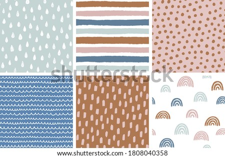 Set of hand drawn vector abstract doodle patterns. Seamless geometric backgrounds. Ink doodles. Rainbow, stripes, dots, rain drops, brush strokes.