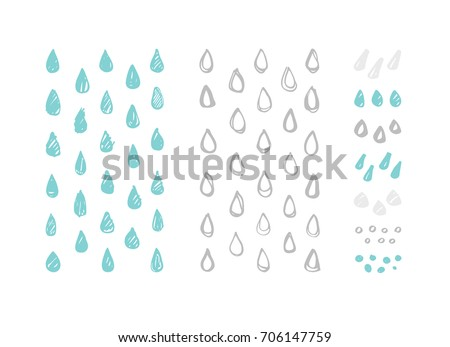 Set of hand drawn vector raindrops. Artistic design elements isolated on a white background