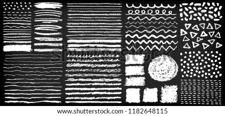 Set of hand painted chalk crayon brushes on a blackboard style background. Grunge vector illustration.