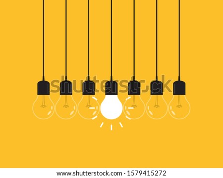 Set of hanging light bulbs with one glowing. Leadership, power and uniqueness concept.
