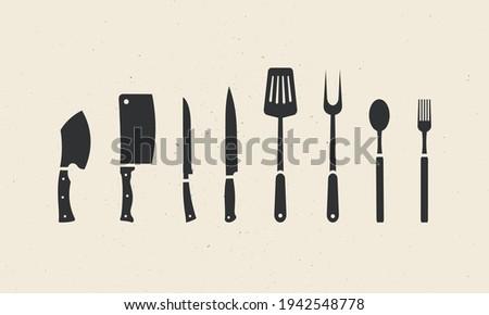 Set of kitchen utensils. Hand-forged cleaver, cleaver, boning, carving knives, spatula, carving fork, spoon, and fork icons. Set of kitchenware icons for restaurants, kitchens. Vector illustration   Stock photo ©