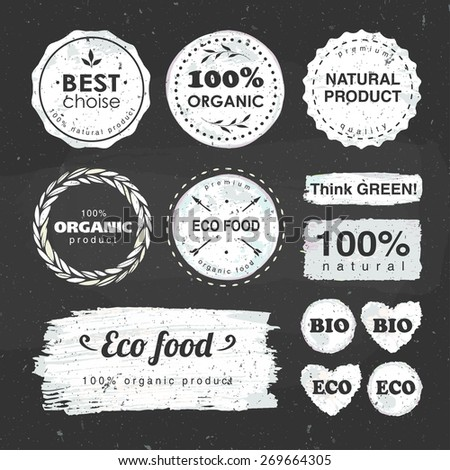 set of labels for eco food and organic products drawn with chalk on a blackboard