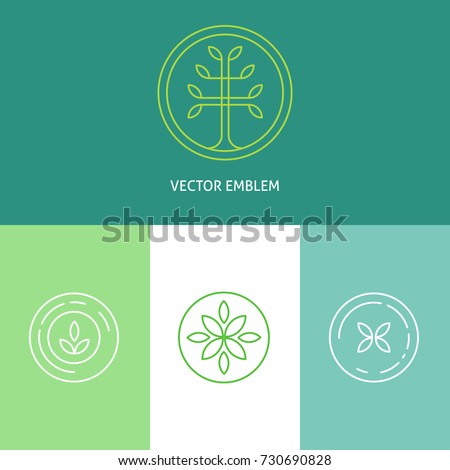 Set of logo templates and emblems with abstract tree and flowers. Vector linear nature design