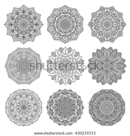 Set of mandalas for coloring book. Decorative round ornaments. Anti-stress therapy patterns. Weave design elements. Yoga logos, backgrounds for meditation poster. Unusual flower shape. Oriental vector