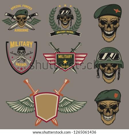 Set of military emblems. Paratrooper skull with crossed knives.Design element for logo, label, emblem, sign. Vector illustration
