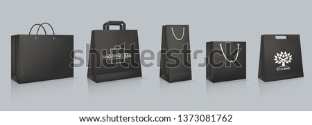 Set of mockup of realistic black paper bag with logotype. Corporate identity blank packaging, shopping bag paper mockup. Branding packaging template with handles. Gift boxing. Vector illustration.