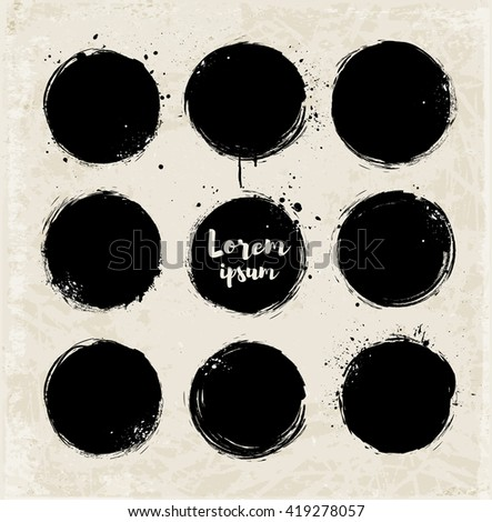 Set of nine black grunge circles with splashes on vintage background. Vector illustration.