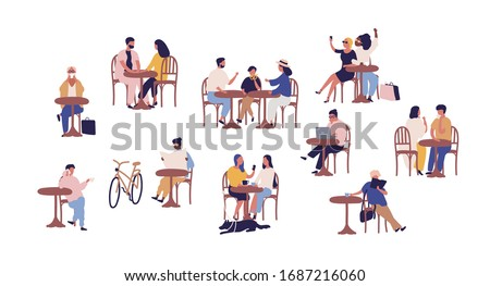 set of people sitting at table