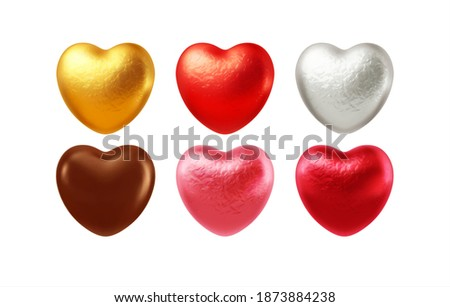 Set of realistic heart shaped chocolates wrapped in foil candy wrapper. Festive design element for Happy Valentines Day. Vector illustration EPS10 Stock photo ©
