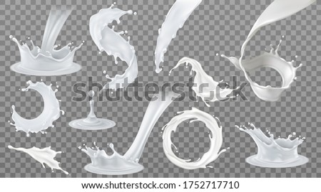 Set of realistic milk splashes of various shape with drops isolated on transparent background vector illustration.